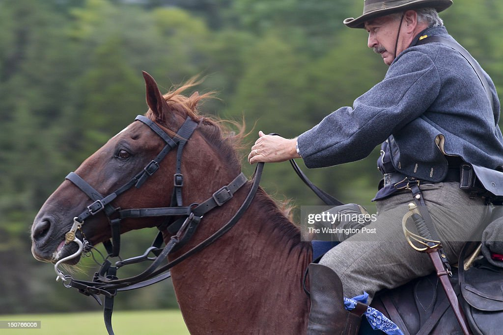 Tony Mallory, of Fairfax, representing a soldier from the 4th Virginia Black Horse Cavalry unit of the Confederate army, during reenactments commemorating the 150th anniversary of the Second Battle of Manassas/Bull Run at Brawner Farm outside Gainesville, VA, Saturday August 25, 2012. Photo by Dayna Smith/for the Washington Post)