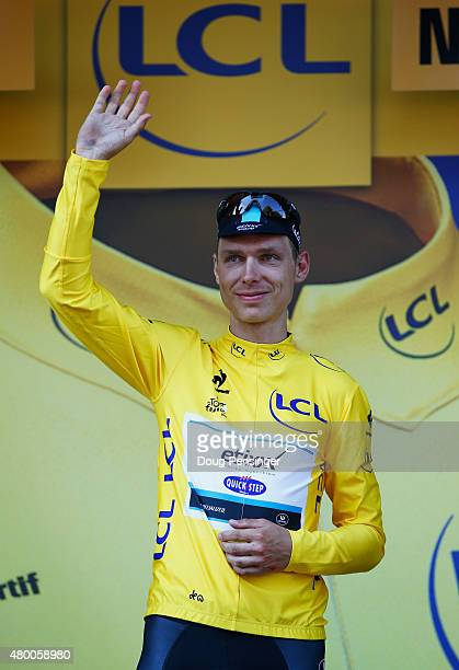 Tony Martin of Germany and EtixxQuick Step celebrates as he is awarded the yellow jersey on the podium after stage six of the 2015 Tour de France a...