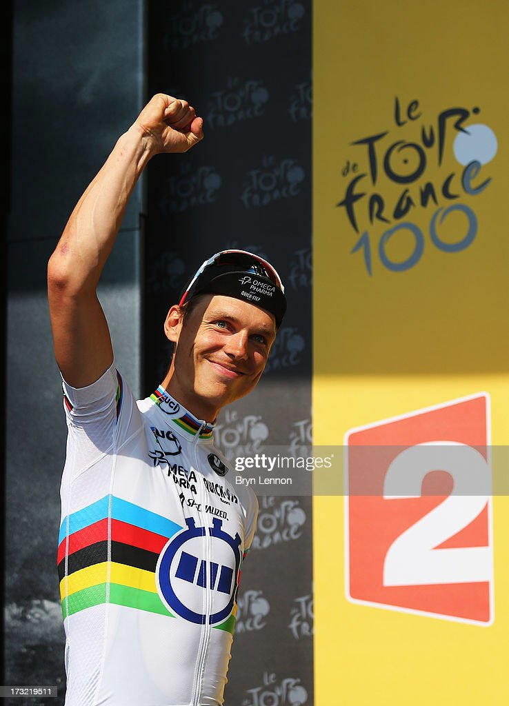 <a gi-track='captionPersonalityLinkClicked' href=/galleries/search?phrase=Tony+Martin+-+Cyclist&family=editorial&specificpeople=5399396 ng-click='$event.stopPropagation()'>Tony Martin</a> of Germany and Team Omega Pharma Quick-Step celebrates on the podium after winning stage eleven of the 2013 Tour de France, a 33KM Individual Time Trial from Avranches to Mont-Saint-Michel, on July 10, 2013 in Avranches, France.