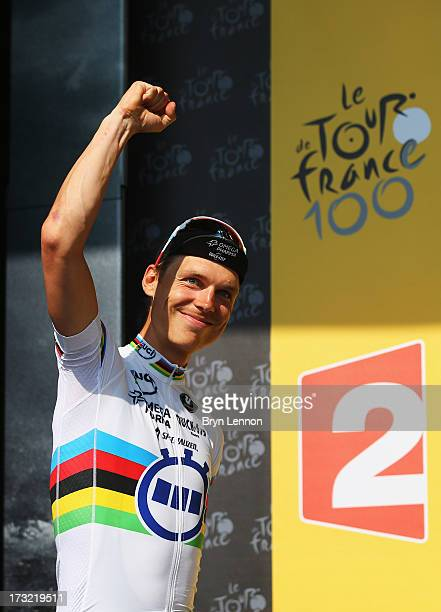 Tony Martin of Germany and Team Omega Pharma QuickStep celebrates on the podium after winning stage eleven of the 2013 Tour de France a 33KM...