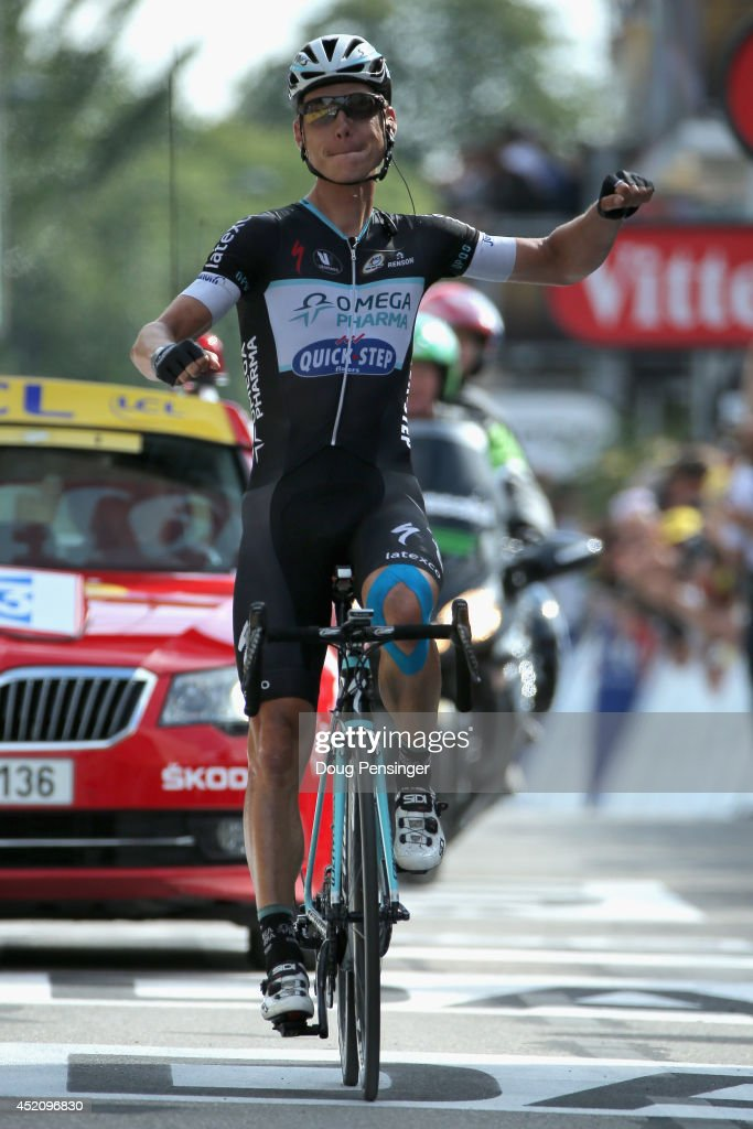 Tony Martin of Germany and the Omega Pharma - Quick-Step Cycling Team celebrates as he crosses the finish line to win stage nine of the 2014 Le Tour de France from Gerardmer to Mulhouse on July 13, 2014 in Mulhouse, France.