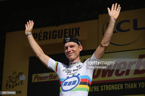 Tony Martin of Germany and the Omega Pharma QuickStep Cycling Team celebrates on the podium after winning the individual time trial during the...