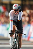 Tony Martin of Germany celebrates crossing the line in first place during the Elite Men's Time Trial from Montecatini Terme to Florence on September...