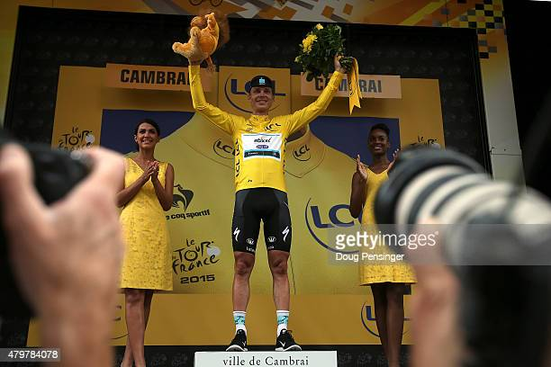 Tony Martin of Germany riding for EtixxQuickStep takes the podium after claiming the overall race leaders jersey with his victory in stage four of...