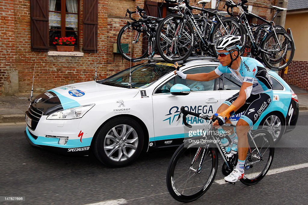 Tony Martin of Germany riding for Omega Pharma-Lotto signals the team car as he returns to the peloton during stage four of the 2012 Tour de France from Abbeville to Rouen on July 4, 2012 in Rouen, France.