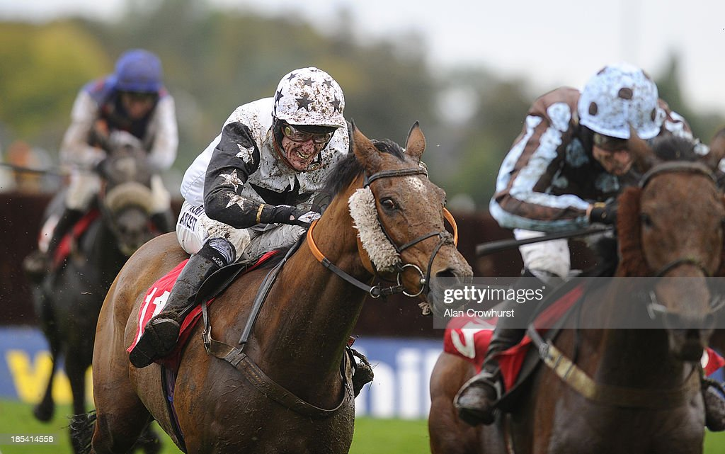 Tony McCoy in action at Kempton Park racecourse on October 20, 2013 in Sunbury, England.