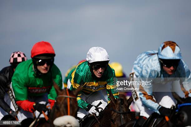 Tony McCoy in action on Shutthefrondoor on Crabbie's Grand National day at Aintree racecourse on April 11 2015 in Liverpool England
