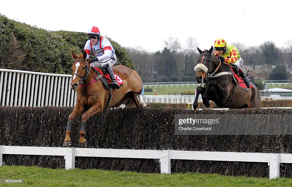 Tony McCoy jumps the second on Kapga De Cerisy with Gallox Bridge ridden by Richard Johnson behind during The Kilbrittain Castle novices steeple chase at Sandown Park racecourse on February 22, 2013 in Esher, England.