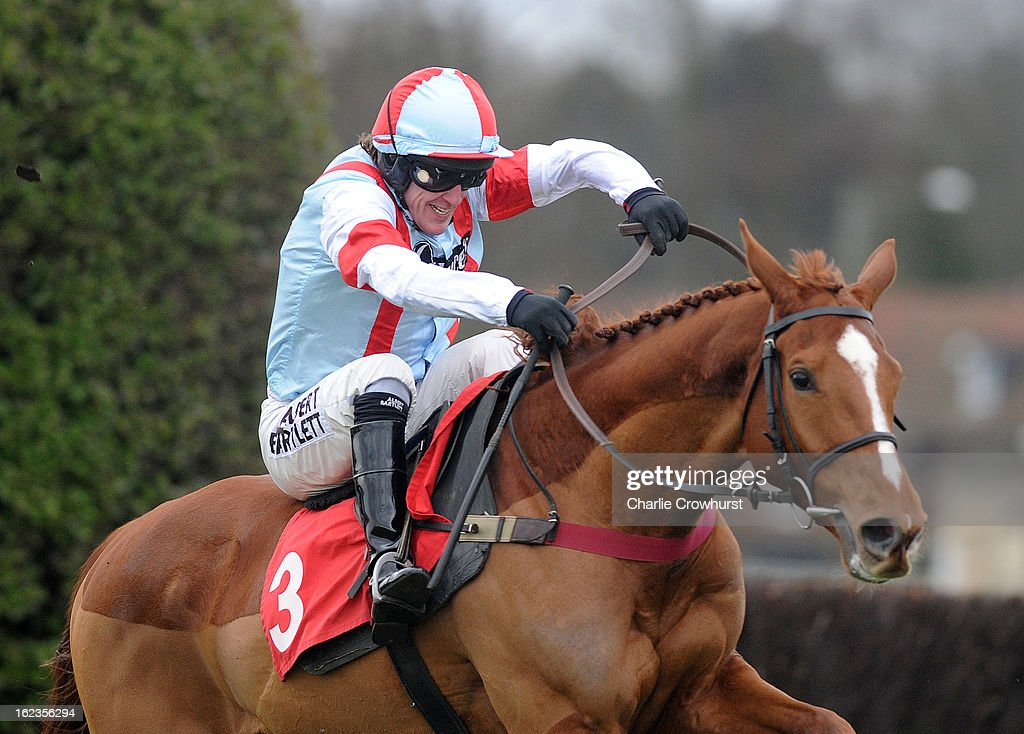 Tony McCoy just about holds onto Kapga De Cerisy after hitting the last fence hard in The Kilbrittain Castle novices steeple chase at Sandown Park racecourse on February 22, 2013 in Esher, England.