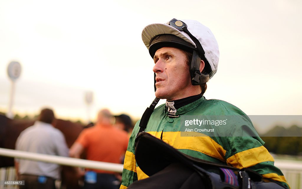 Tony McCoy makes his way back to the weighing room after an evenings racing without a winner at Worcester racecourse on July 16, 2014 in Worcester, England.