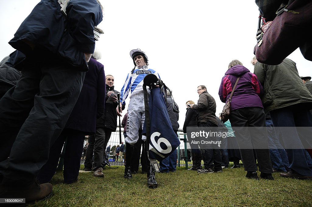 Tony McCoy makes his way back to the weighing room at Huntingdon racecourse on March 03, 2013 in Huntingdon, England.