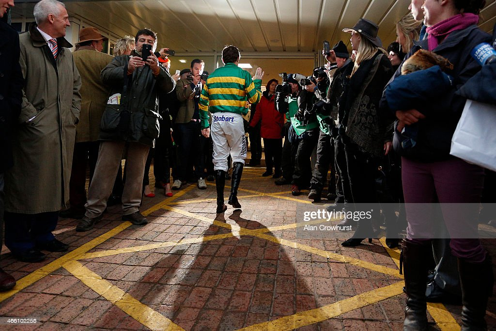 Tony McCoy returns after his last ride at Cheltenham before retiring at the end of the season during Gold Cup day at the Cheltenham Festival at...