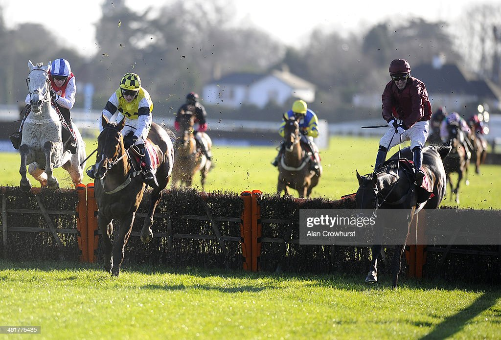 Tony McCoy riding Goodwood Mirage (R) clear the last to win The William Hill - In The App Store Juvenile Hurdle Race at Kempton Park racecourse on January 11, 2014 in Sunbury, England.