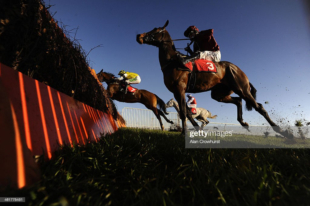 Tony McCoy riding Goodwood Mirage (nearest) clear the last to win The William Hill - In The App Store Juvenile Hurdle Race at Kempton Park racecourse on January 11, 2014 in Sunbury, England.