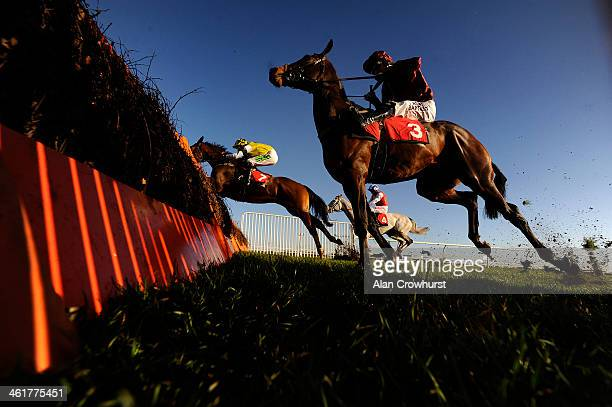 Tony McCoy riding Goodwood Mirage clear the last to win The William Hill In The App Store Juvenile Hurdle Race at Kempton Park racecourse on January...