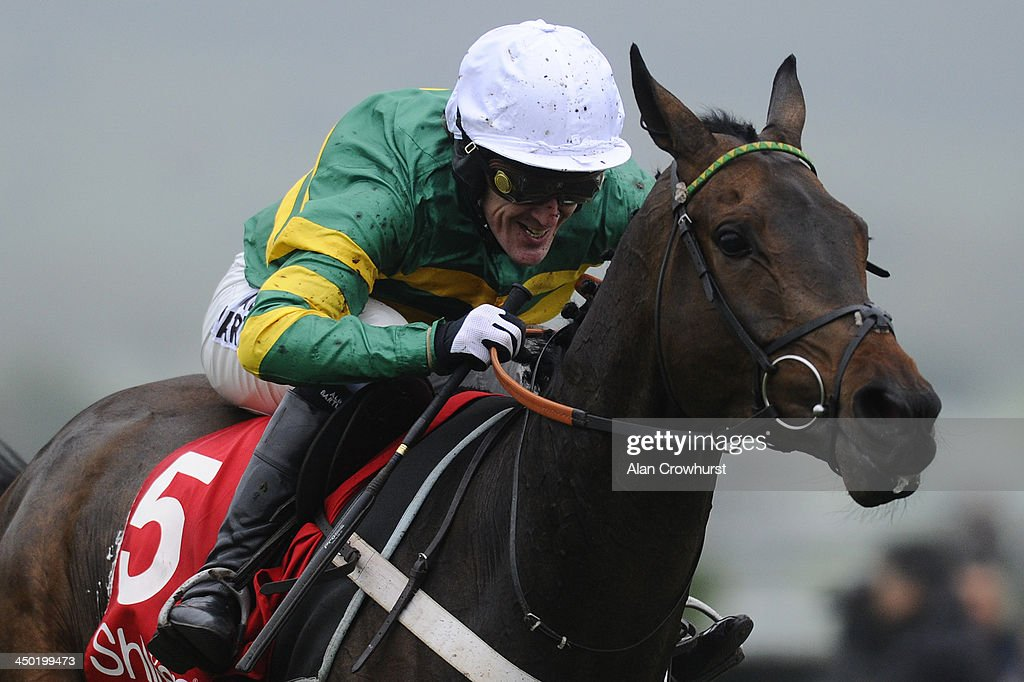 Tony McCoy riding Kid Cassidy win The Shloer Steeple Chase at Cheltenham racecourse on November 17, 2013 in Cheltenham, England.