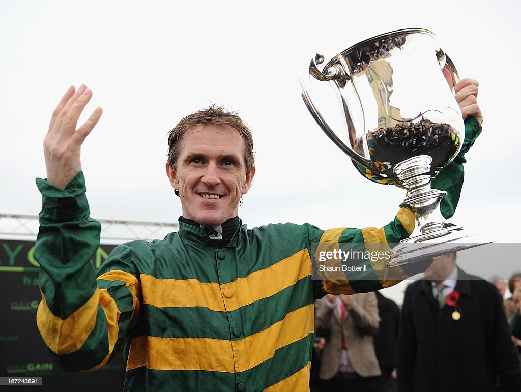 Tony McCoy riding Mountain Tunes celebrates after winning the Weatherbys Novices' Hurdle Race for his 4000th winner on November 7, 2013 in Towcester, England.