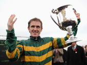 Tony McCoy riding Mountain Tunes celebrates after winning the Weatherbys Novices' Hurdle Race for his 4000th winner on November 7 2013 in Towcester...