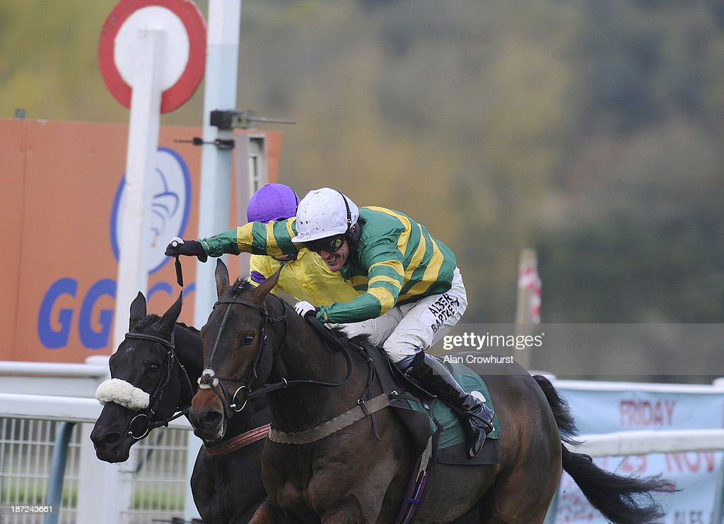 Tony McCoy riding Mountain Tunes (R) celebrates victory to give Tony McCoy his 4000th career win in The Weatherbys Novices' Hurdle Race at Towcester racecourse on November 07, 2013 in Towcester, England.