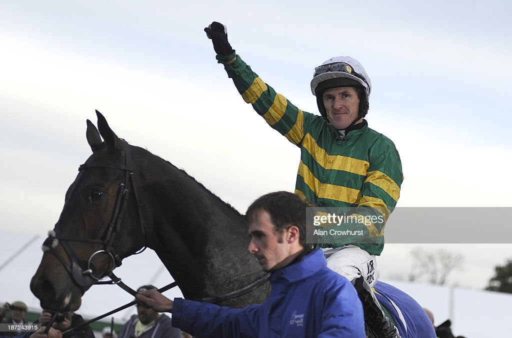 Tony McCoy riding Mountain Tunes celebrates victory to give Tony McCoy his 4000th career win in The Weatherbys Novices' Hurdle Race at Towcester racecourse on November 07, 2013 in Towcester, England.
