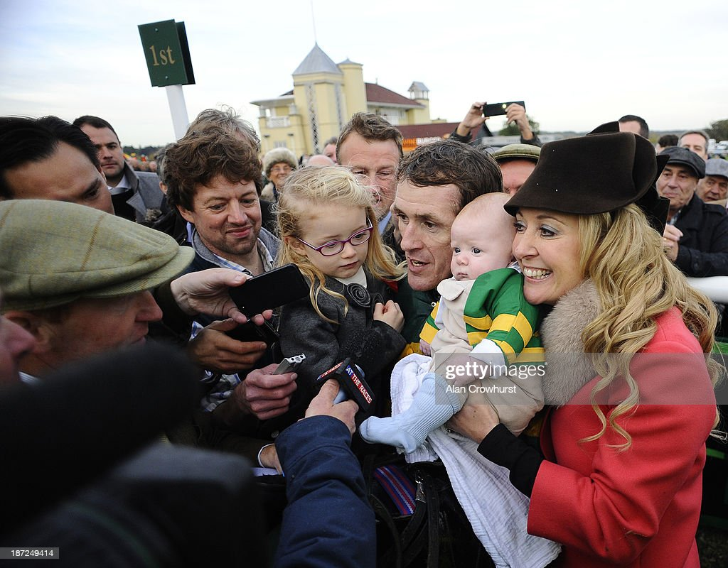 Tony McCoy riding Mountain Tunes (C) celebrates victory to give Tony McCoy his 4000th career win in The Weatherbys Novices' Hurdle Race with daughter Eve and son Archie Peter and wife Chanelle at Towcester racecourse on November 07, 2013 in Towcester, England.