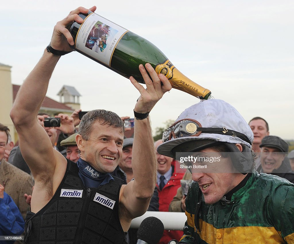 Tony McCoy riding Mountain Tunes is congratulated by fellow jockey Andrew Thornton after winning the Weatherbys Novices' Hurdle Race for his 4000th winner on November 7, 2013 in Towcester, England.