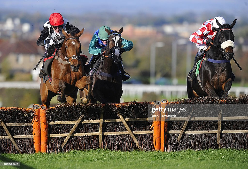 Tony McCoy riding Oscar Fortune (L) clear the last to win The Mr & Mrs Handley Ruby Wedding Novices' Hurdle Race at Carlisle racecourse on November 03, 2013 in Carlisle, England.