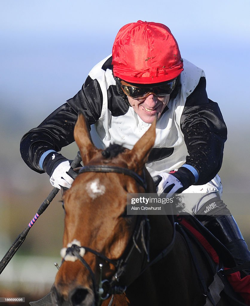 Tony McCoy riding Oscar Fortune clear the last to win The Mr & Mrs Handley Ruby Wedding Novices' Hurdle Race at Carlisle racecourse on November 03, 2013 in Carlisle, England.
