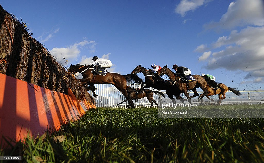 Tony McCoy riding Royal Boy (white) on their way to winning The williamhill.com Tolworth Hurdle Race at Kempton Park racecourse on January 11, 2014 in Sunbury, England.