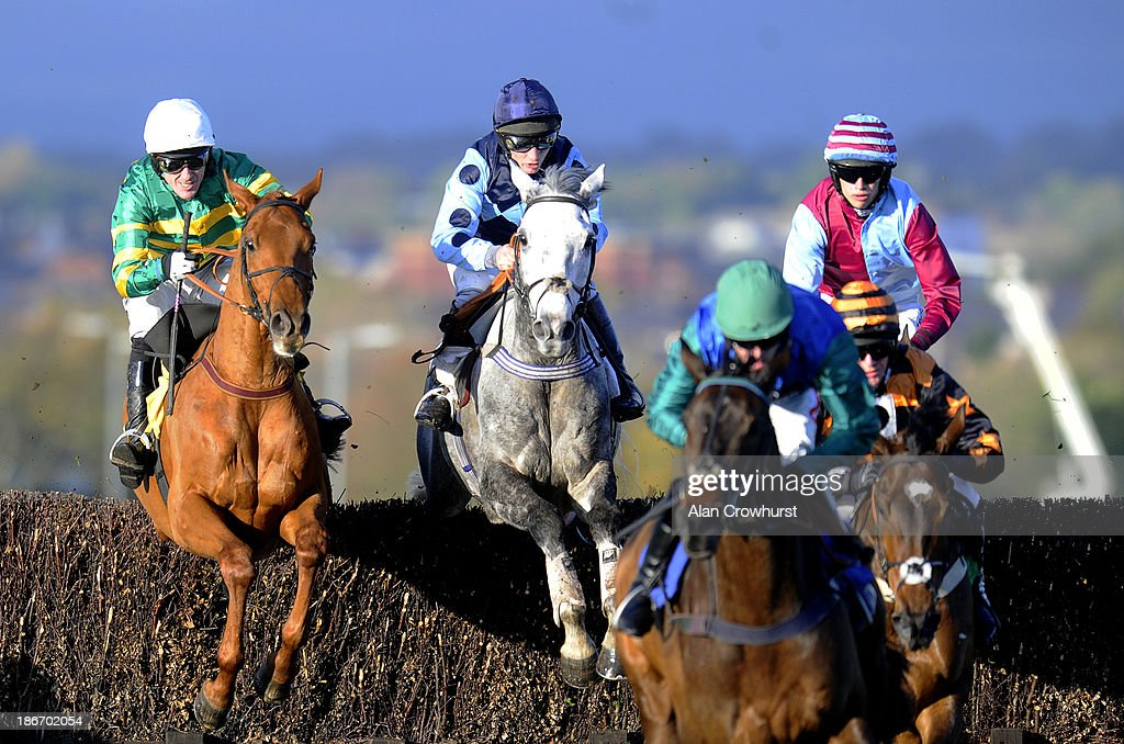 Tony McCoy riding Tap Night (L) in action at Carlisle racecourse on November 03, 2013 in Carlisle, England.