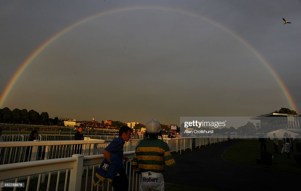 Tony McCoy stands under a rainbow in the parade ring at Worcester racecourse on July 16, 2014 in Worcester, England.