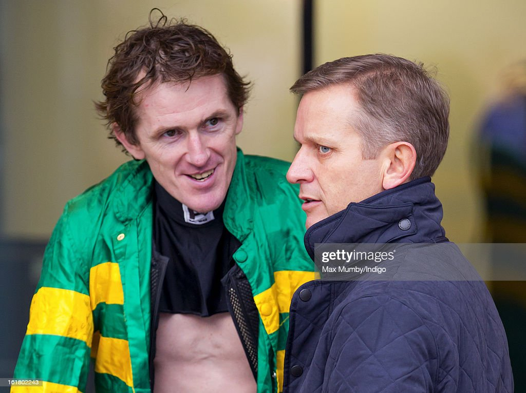 Tony McCoy talks with <a gi-track='captionPersonalityLinkClicked' href=/galleries/search?phrase=Jeremy+Kyle&family=editorial&specificpeople=680413 ng-click='$event.stopPropagation()'>Jeremy Kyle</a> at the Betfair Ascot Chase Day at Ascot Racecourse on February 16, 2013 in Ascot, England.