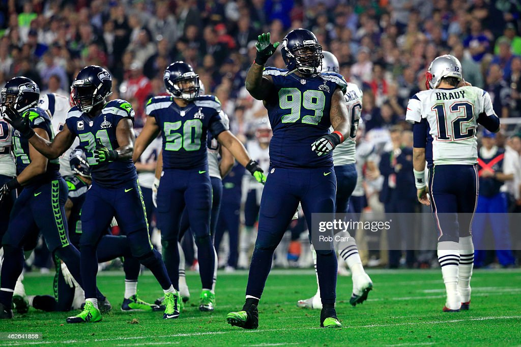 Tony McDaniel of the Seattle Seahawks reacts after stopping the New England Patriots on third down as Tom Brady looks on during Super Bowl XLIX at...