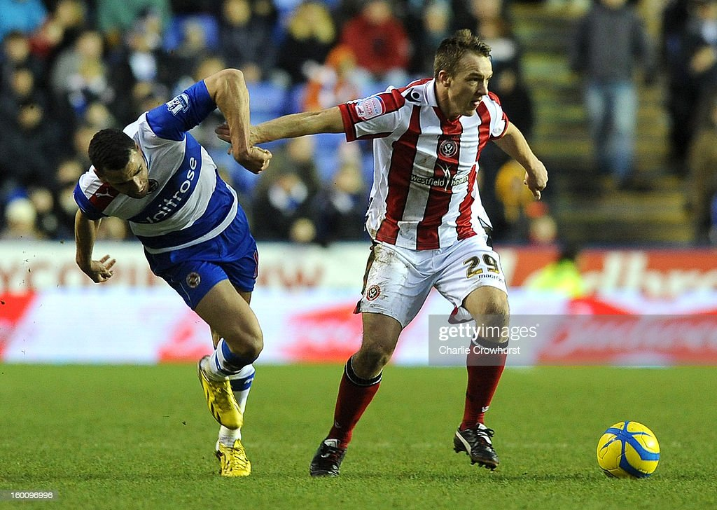 Tony McMahon of Sheffield United holds off Hal Robson-Kanu of Reading during the FA Cup Fourth Round match between Reading and Sheffield United at the Madejski Stadium on January 26, 2013 in London England.
