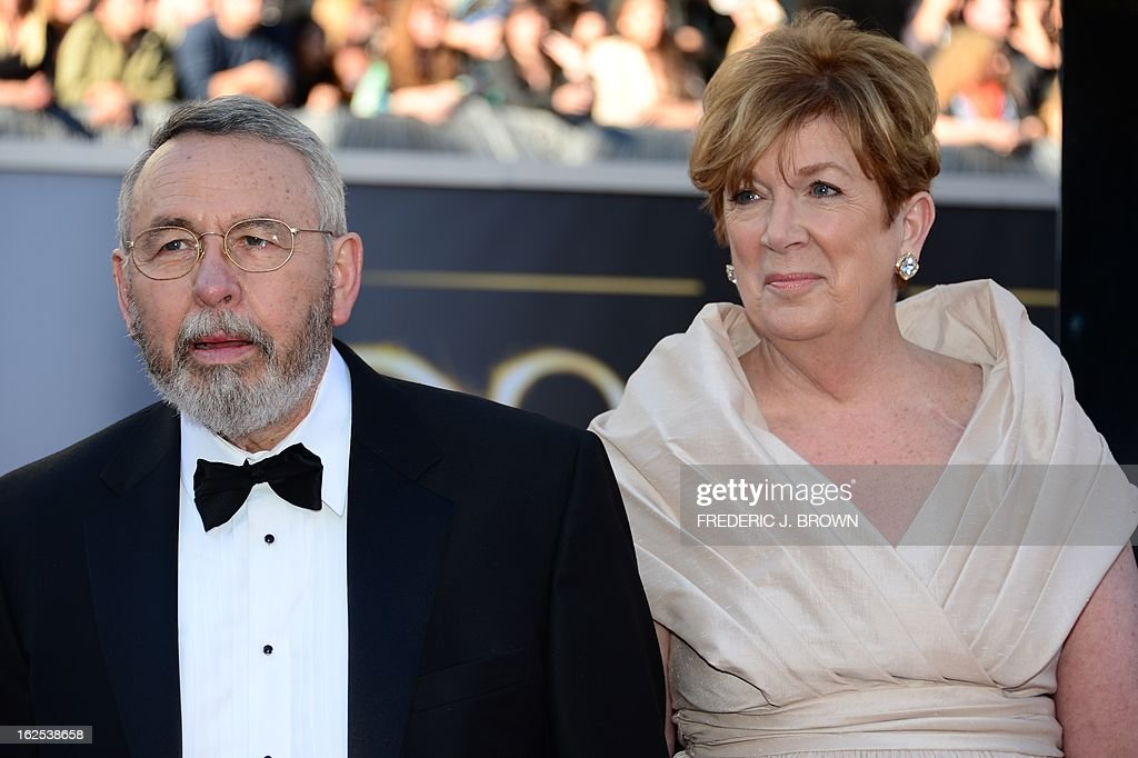 Tony Mendez and guest arrive on the red carpet for the 85th Annual Academy Awards on February 24, 2013 in Hollywood, California.