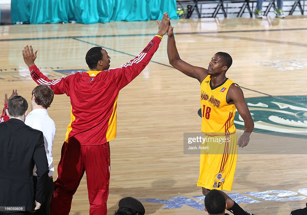 Tony Mitchell #18 of the Fort Wayne Mad Ants high-fives a teammate while playing against the Tulsa 66ers during the 2013 NBA D-League Showcase on January 10, 2013 at the Reno Events Center in Reno, Nevada.