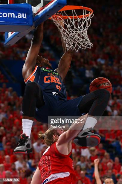 Tony Mitchell of the Taipans dunks the ball against Jesse Wagstaff of the Wildcats during the game two NBL Semi Final match between the Perth...
