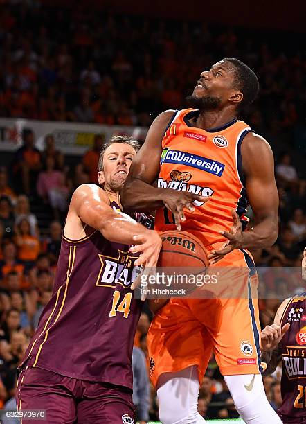 Tony Mitchell of the Taipans is blocked by Daniel Kickert of the Bullets during the round 17 NBL match between the Cairns Taipans and the Brisbane...