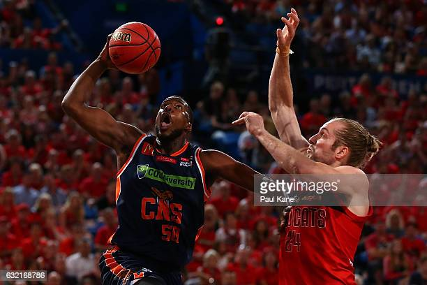 Tony Mitchell of the Taipans lays up against Jesse Wagstaff of the Wildcats during the round 16 NBL match between the Perth Wildcats and the Cairns...