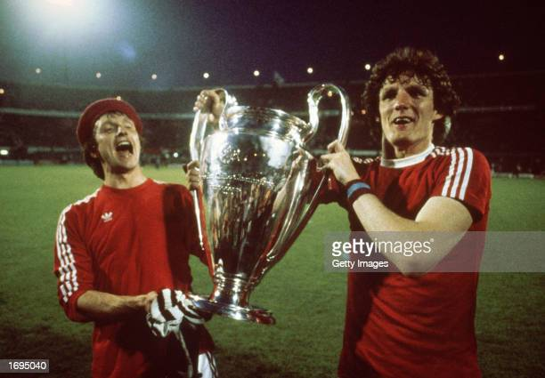 Tony Morley and Allan Evans of Aston Villa lift the cup up after the European Cup Final between Bayern Munich and Aston Villa held on May 26 1982 at...