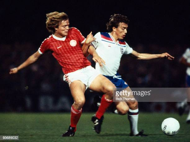 Tony Morley of England with Soren Lerby of Denmark during the Denmark v England European Championship Qualifying match played at the Idraetsparken...
