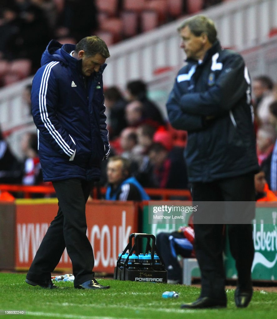 <a gi-track='captionPersonalityLinkClicked' href=/galleries/search?phrase=Tony+Mowbray&family=editorial&specificpeople=3470107 ng-click='$event.stopPropagation()'>Tony Mowbray</a>, manager of Middlesbrough looks on during the FA Cup Third Round match between Middlesbrough and Shrewsbury Town at Riverside Stadium on January 7, 2012 in Middlesbrough, England.
