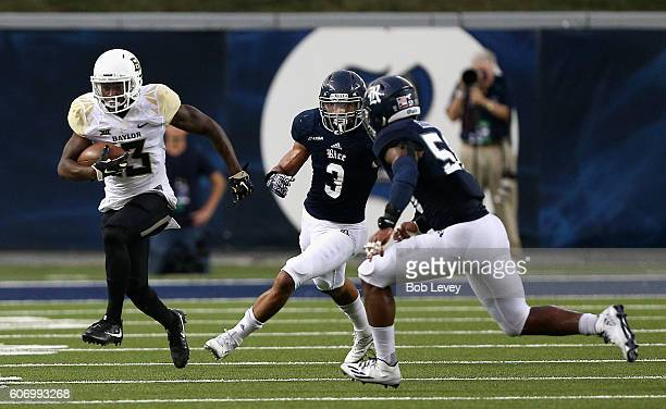 Tony Nicholson of the Baylor Bears rushes past Derek Brown of the Rice Owls and Emmanuel Ellerbee at Rice Stadium on September 16 2016 in Houston...