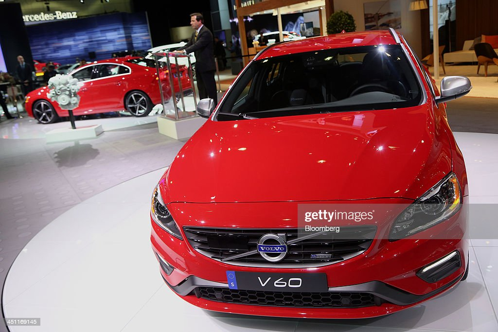 Tony Nicolosi, president and chief executive officer for Volvo Cars of North America LLC, speaks while a Volvo AG V60 vehicle is displayed during the LA Auto Show in Los Angeles, California, U.S., on Thursday, Nov. 21, 2013. The 2013 LA Auto Show is open to the public Nov. 22 - Dec. 1. Photographer: Jonathan Alcorn/Bloomberg via Getty Images