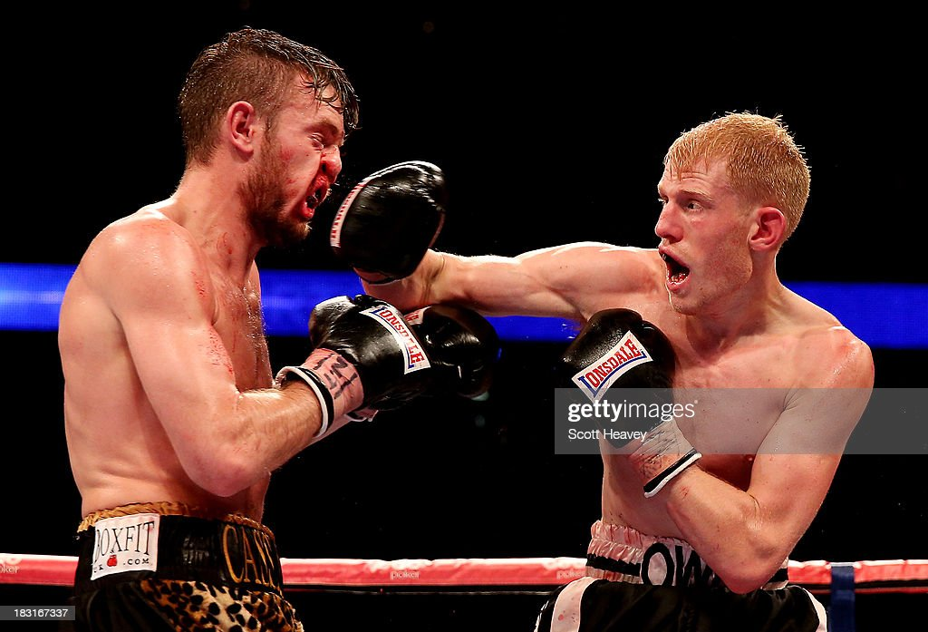 Tony Owen (R) catches Danny Connor with a right hook during their Southern Area Light-Welterweight Championship bout at O2 Arena on October 5, 2013 in London, England.