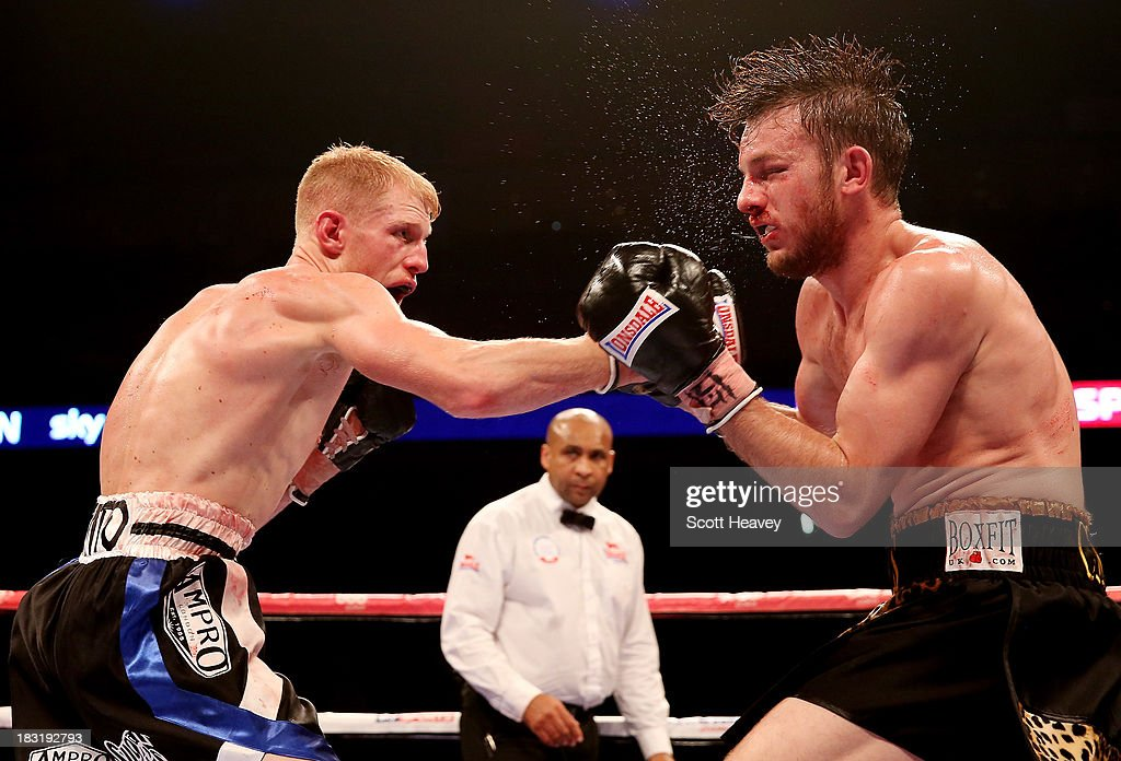 Tony Owen (L) catches Danny Connor with a right hook during their Southern Area Light-Welterweight Championship bout at O2 Arena on October 5, 2013 in London, England.