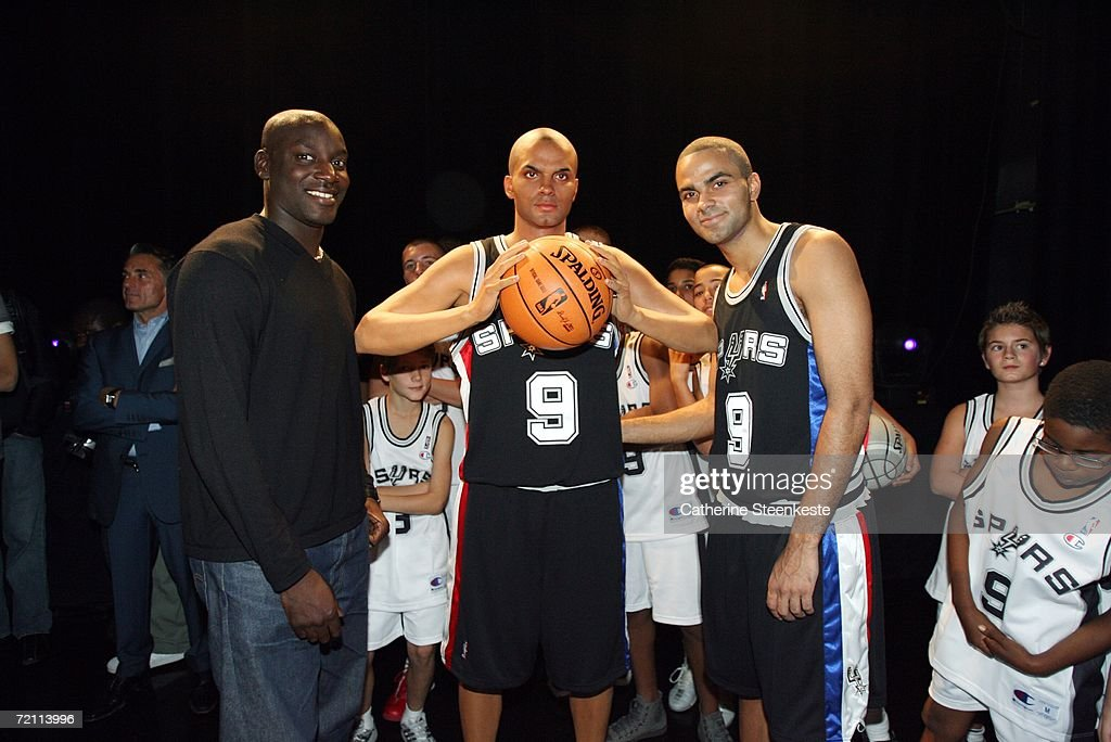 Tony Parker (L) #9 of the San Antonio Spurs poses with Ladji Doucoure, (L) World Champion 110m hurdle, and a wax figure of Parker at the Grevin Wax Museum during the NBA Europe Live presented by EA Sports on October 7, 2006 in Paris, France.
