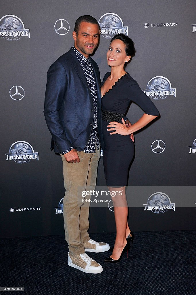 Tony Parker and Axelle Francine attend the 'Jurassic World' Photocall at UGC Normandie on May 29 2015 in Paris France
