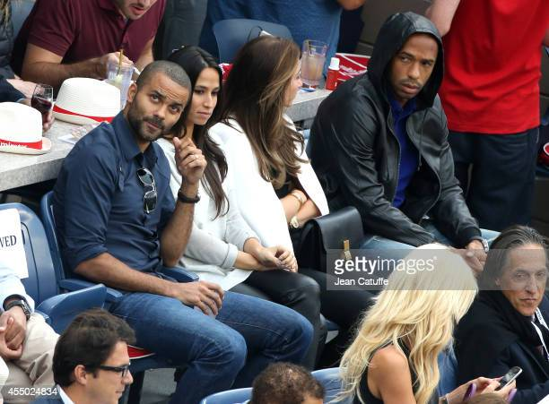 Tony Parker and his wife Axelle Parker Thierry Henry and his girlfriend Andrea Rajacic attend the men's final on Day 15 of the 2014 US Open at USTA...