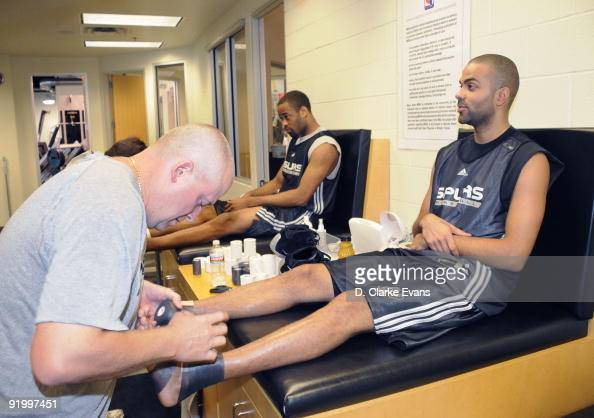 Tony Parker and Malik Hairston of the San Antonio Spurs gets taped during training camp on October 19 2009 at the ATT Center in San Antonio Texas...
